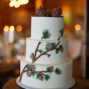 A three-tiered fondant-frosted cake, decorated with pinecones, was cut and served concluding dinner.   Cake: Intricate Icings Cake Design