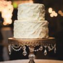 A two-tiered buttercream-frosted cake was cut and served concluding dinner.   Reception Venue: Red Butte Garden  Caterer: Cuisine Unlimited Catering and Special Events