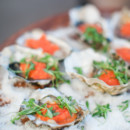 Guests enjoyed fresh oysters as they mingled on the hotel rooftop.  Reception Venue:Canary Hotel  Catering:Canary Hotel