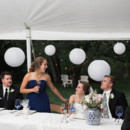 The white reception tent was strung with romantic twinkle lights and white paper lanterns.  Dress Designer:David's Bridal  Bridesmaid Dresses: J.Crew  Groom and Groomsmen Attire: Men's Wearhouse  Floral Designer: Mayfield Floral
