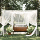 The ceremony altar was draped in fabric and surrounded with pots of white hydrangeas.  Floral Designer: Mayfield Floral