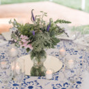 They were clothed in beautiful blue block printed linens. Queen Anne's lace, goldenrod, veronica, stock, waxflower, and pittosporum were arranged in glass vases and displayed on round mirrors.  Floral Designer: Mayfield Floral   Caterer: Casa Dolce
