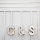 The couple's monogram was spelled out in vintage tin letters.  Event Planner: Sara Malone