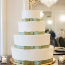 A four-tiered cake was decorated with ribbon.  Cake:Ye Olde Pie Shoppe