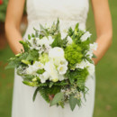 The bouquets featured roses, hydrangeas, lily of the valley, green trick, ferns, and seeded eucalyptus.  Dress Designer: Wtoo by Watters fromDiane's Formal Affair  Floral Designer:HotHouse Design Studio & Prophouse Rentals