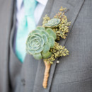 The groom wore a three-piece gray suit, accessorized with a tie. A succulent boutonniere was pinned to his lapel.    Venue: The Historic Cottage (San Clemente)  Event Planner: Events by Valerie