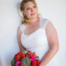 The bride wore a sheath gown with a Queen Anne's neckline, accessorized with a braided updo.  Venue:The Historic Cottage (San Clemente)  Event Planner:Events by Valerie  Hair and Makeup Artist:Blush by M. Marie