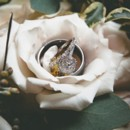 Gina's engagement ring was a glistening round cut diamond with pave diamonds in a channel setting.  Jeweler:Koehn & Koehn Jewelers  Flowers: Econo Foods
