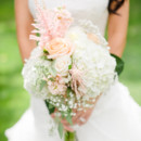 Rosie's bouquet featured roses, hydrangeas, astilbe, and baby's breath.  Venue:Lyons Farmette