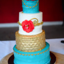 A four-tiered fondant-frosted cake was cut concluding dinner.  Cake: Richele Ray Charles