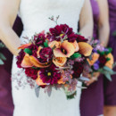 The bride's bouquet was wrapped with ribbon around the stems.  Venue:Shenandoah Mill  Event Planner:Pink of Perfection Events  Floral Designer:Blooming Fields