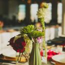 Tables were decorated with white linens, vintage vase and vessel centerpieces, and lanterns.  Venue:Ambient Plus Studio  Event Planner: Yuri Kim ofWedding Designs