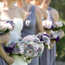 Bridesmaids wore short purple chiffon dresses in various necklines and carried bouquets of roses, hydrangeas, succulents, and dusty miller.   Dress Designer: Brides by Demetrios  Bridesmaid Dresses: Brides by Demetrios  Floral Designer: The Flower Studio