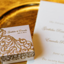 Favor boxes sat atop each charger plate.   Reception Venue/Caterer: The Society Room of Hartford  Invitations: Gunasiri Creations