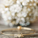 Jewelry included an initial heart bracelet.  Venue:Willow Creek Winery  Event Planner/Cake: M.Y. Stylized Events