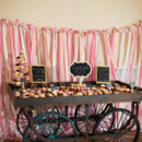 The dessert display included an assortment of sweets like cupcakes.  Venue:Willow Creek Winery  Event Planner/Cake: M.Y. Stylized Events
