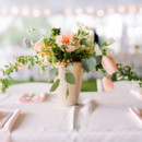 Peach pots filled with eucalyptus, hypericum berries, tulips, garden roses, and Queen Anne's lace.  Reception Venue: Tuckahoe Plantation  Event Planner: A Grand Affair  Floral Designer: Petals & Twigs