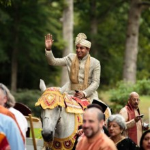 "<strong class='info-row'>Hopkins Studios</strong> <div class='info-row description'><html>  <head></head>  <body>    The big day began with a baraat, which is a processional parade, on a white horse.   Venue:    <a href=""http://www.weddingwire.com/biz/keswick-vineyards-keswick/a4d1dbe4e72daaa6.html?utm_source=ww&utm_medium=photo-gallery&utm_campaign=real-weddings"" target=""_blank"">Keswick Vineyards</a>  Event Planner:    <a href=""http://www.weddingwire.com/biz/working-brides-wedding-planner-germantown/f30de8f252ca0ce2.html?utm_source=ww&utm_medium=photo-gallery&utm_campaign=real-weddings"" target=""_blank"">Working Brides Wedding Planner</a>      </body> </html></div>"