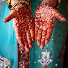"<strong class='info-row'>Hopkins Studios</strong> <div class='info-row description'><html>  <head></head>  <body>    The bride's hands were painted with henna tattoos.   Venue:    <a href=""http://www.weddingwire.com/biz/keswick-vineyards-keswick/a4d1dbe4e72daaa6.html?utm_source=ww&utm_medium=photo-gallery&utm_campaign=real-weddings"" target=""_blank"">Keswick Vineyards</a>  Event Planner:    <a href=""http://www.weddingwire.com/biz/working-brides-wedding-planner-germantown/f30de8f252ca0ce2.html?utm_source=ww&utm_medium=photo-gallery&utm_campaign=real-weddings"" target=""_blank"">Working Brides Wedding Planner</a>      </body> </html></div>"