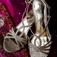 "<strong class='info-row'>Hopkins Studios</strong> <div class='info-row description'><html>  <head></head>  <body>    She accessorized her lengha with a pair of glitter peep-toe high heels.   Venue:    <a href=""http://www.weddingwire.com/biz/keswick-vineyards-keswick/a4d1dbe4e72daaa6.html?utm_source=ww&utm_medium=photo-gallery&utm_campaign=real-weddings"" target=""_blank"">Keswick Vineyards</a>  Event Planner:    <a href=""http://www.weddingwire.com/biz/working-brides-wedding-planner-germantown/f30de8f252ca0ce2.html?utm_source=ww&utm_medium=photo-gallery&utm_campaign=real-weddings"" target=""_blank"">Working Brides Wedding Planner</a>      </body> </html></div>"
