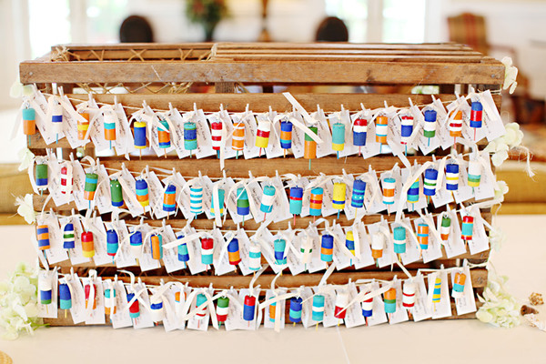Mini Buoy Escort Cards Displayed On A Rustic Crate Venue Bonnet Island Estate