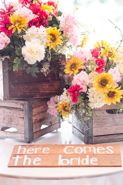 Rustic Wooden Crates Were Filled With Arrangements Of Sunflowers Hydrangeas Peonies And Roses