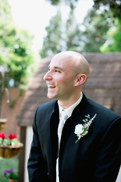 Christopher's black tuxedo was accessorized with a collarless jacket, white vest, and tie.  Ceremony Venue: Point Pleasant Beach  Reception Venue: Versailles Ballroom at the Ramada of Toms River