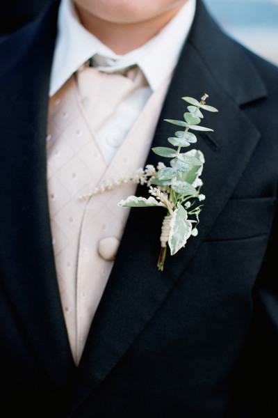 Groomsmen wore boutonnieres featuring eucalyptus leaves and pittosporum.  Ceremony Venue: Point Pleasant Beach  Reception Venue: Versailles Ballroom at the Ramada of Toms River