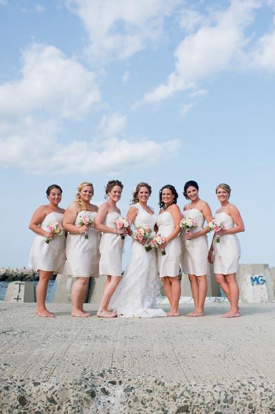 Bridesmaids wore short neutral silk dresses.  Ceremony Venue: Point Pleasant Beach  Dress Designer:Maggie Sottero