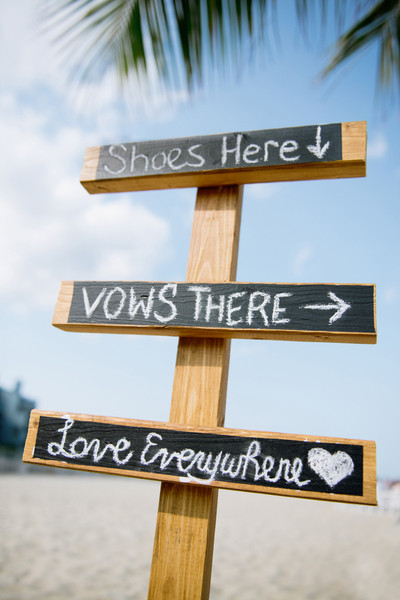 "A chalkboard sign said, ""Shoes here, vows there, love everywhere."" How cute is that?   Ceremony Venue: Point Pleasant Beach  Reception Venue: Versailles Ballroom at the Ramada of Toms River"
