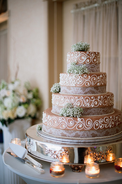 A four-tiered fondant-frosted cake was cut concluding dinner.   Reception Venue: Versailles Ballroom at the Ramada of Toms River