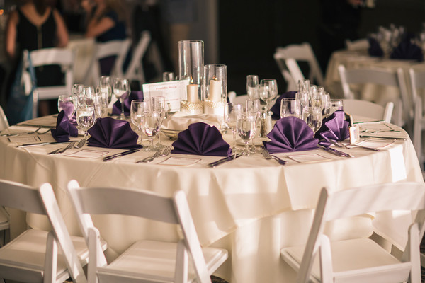 The Tables Were Decorated With Classic Ivory Tablecloths And Plum Purple  Dinner Napkins. Venue: