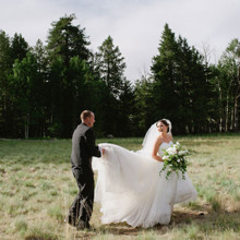 220x220 sq 1466023706588 flagstaff wedding bride  groom holding gown in pin