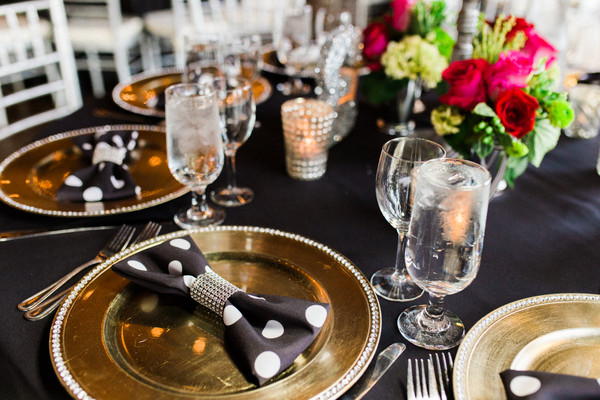 Reception Tables Were Draped With Black Linens Gold Charger Plates And Polka Dot Napkins