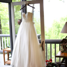 "<strong class='info-row'>Thirteenth Moon Photography LLC</strong> <div class='info-row description'><html>  <head></head>  <body>    Emilie wore a sweetheart tulle ballgown.  Dress Designer:   <a href=""http://www.weddingwire.com/biz/demetrios-lake-grove-scottsdale/44433c4cef764c18.html"" target=""_blank"">Demetrios</a>from Brides by Demetrios     </body> </html></div>"