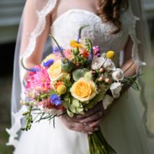 "<strong class='info-row'>Thirteenth Moon Photography LLC</strong> <div class='info-row description'><html>  <head></head>  <body>    Emilie's bouquet included roses, snapdragons, craspedia, veronica, hypericum berries, poppy pods, and thistle.  Dress Designer:   <a href=""http://www.weddingwire.com/biz/demetrios-lake-grove-scottsdale/44433c4cef764c18.html"" target=""_blank"">Demetrios</a>from Brides by Demetrios  Floral Designer: Earth Blooms Flower Farm     </body> </html></div>"