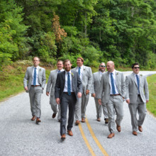 <strong class='info-row'>Thirteenth Moon Photography LLC</strong> <div class='info-row description'><html>  <head></head>  <body>    Zach and the groomsmen looked stylish in gray suits and blue ties.          </body> </html></div>