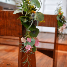 <strong class='info-row'>Thirteenth Moon Photography LLC</strong> <div class='info-row description'><html>  <head></head>  <body>    The pews were dressed up with fresh flowers.  Floral Designer: Earth Blooms Flower Farm     </body> </html></div>