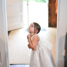 <strong class='info-row'>Thirteenth Moon Photography LLC</strong> <div class='info-row description'><html>  <head></head>  <body>    The flower girl rang the chapel's bell in celebration!       </body> </html></div>