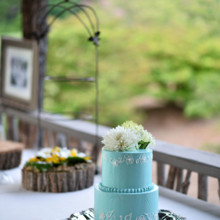"""<strong class='info-row'>Thirteenth Moon Photography LLC</strong> <div class='info-row description'><html>  <head></head>  <body>    A two-tier cake was served concluding dinner.  Reception Venue:   <a href=""""http://www.weddingwire.com/reviews/the-village-green-cashiers/4b707e7bc0582709.html"""" target=""""_blank"""">The Village Green</a>     </body> </html></div>"""