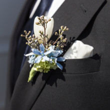 "<strong class='info-row'>Flora Bella Florist</strong> <div class='info-row description'><html>  <head></head>  <body>    His boutonniere was composed of delphinium, tulip, and seeded eucalyptus.  Photo by    <a href=""http://www.weddingwire.com/biz/andrea-weddings-portland/ff8574fb86e5aac9.html"" target=""_blank"">Andrea Weddings</a>  Venue: The China Cabin  Groom and Groomsmen Attire:    <span class=""s2"">Armani</span>   </body> </html></div>"