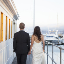 "<strong class='info-row'>Flora Bella Florist</strong> <div class='info-row description'><html>  <head></head>  <body>    <span class=""s1"">Joy and Brad chose their venue because it was a ""landmark building that had a waterfront view of the San Francisco city skyline,"" says Joy. ""We appreciated China Cabin's history and that it was protected and would be there forever!""</span>  Photo by    <a href=""http://www.weddingwire.com/biz/andrea-weddings-portland/ff8574fb86e5aac9.html"" target=""_blank"">Andrea Weddings</a>  Venue: The China Cabin  Wedding Gown:    <a href=""http://www.weddingwire.com/biz/nicole-miller-new-york/7ba0bd20c6f86354.html"" target=""_blank""><span class=""s2"">Nicole Miller</span></a>  Hair Stylist:    <span class=""s2"">Amber Jahn of The Pretty Pretty Collective</span>     <span class=""s3"">Makeup Artist: </span>   <span class=""s4"">Jessa Blades of <a href=""http://www.weddingwire.com/biz/blades-natural-beauty-brooklyn/eb593c813f4152d2.html"" target=""_blank"">Blades Natural Beauty</a></span>  Groom and Groomsmen Attire:    <span class=""s2"">Armani</span>   </body> </html></div>"