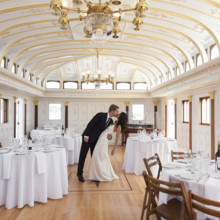 "<strong class='info-row'>Flora Bella Florist</strong> <div class='info-row description'><html>  <head></head>  <body>    The reception was held inside the China Cabin, a historic landmark which was once an 1800s steamship saloon!  Photo by    <a href=""http://www.weddingwire.com/biz/andrea-weddings-portland/ff8574fb86e5aac9.html"" target=""_blank"">Andrea Weddings</a>  Venue: The China Cabin  Wedding Gown:    <a href=""http://www.weddingwire.com/biz/nicole-miller-new-york/7ba0bd20c6f86354.html"" target=""_blank""><span class=""s2"">Nicole Miller</span></a>  Hair Stylist:    <span class=""s2"">Amber Jahn of The Pretty Pretty Collective</span>     <span class=""s3"">Makeup Artist: </span>   <span class=""s4"">Jessa Blades of <a href=""http://www.weddingwire.com/biz/blades-natural-beauty-brooklyn/eb593c813f4152d2.html"" target=""_blank"">Blades Natural Beauty</a></span>  Groom and Groomsmen Attire:    <span class=""s2"">Armani</span>   </body> </html></div>"