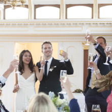 "<strong class='info-row'>Flora Bella Florist</strong> <div class='info-row description'><html>  <head></head>  <body>    Joy and Brad raising celebratory glasses of champagne with family and friends.  Photo by    <a href=""http://www.weddingwire.com/biz/andrea-weddings-portland/ff8574fb86e5aac9.html"" target=""_blank"">Andrea Weddings</a>  Venue: The China Cabin  Wedding Gown:    <a href=""http://www.weddingwire.com/biz/nicole-miller-new-york/7ba0bd20c6f86354.html"" target=""_blank""><span class=""s2"">Nicole Miller</span></a>  Hair Stylist:    <span class=""s2"">Amber Jahn of The Pretty Pretty Collective</span>     <span class=""s3"">Makeup Artist: </span>   <span class=""s4"">Jessa Blades of <a href=""http://www.weddingwire.com/biz/blades-natural-beauty-brooklyn/eb593c813f4152d2.html"" target=""_blank"">Blades Natural Beauty</a></span>  Groom and Groomsmen Attire:    <span class=""s2"">Armani</span>   </body> </html></div>"