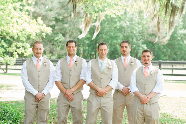 Neil And His Groomsmen Wore Khaki Vests Slacks The Groom Sported A Mint