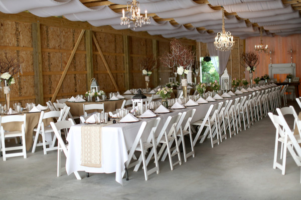 The Reception Space Featured Banquet Tables As Well Round White Folding Chairs