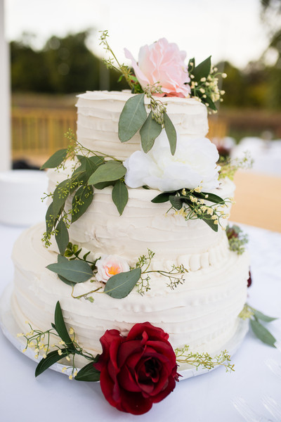 Seeded Eucalyptus And Roses Garnished The Three Tier Buttercream Cake Venue Rentals