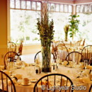 130x130 sq 1370034336369 ivory with glass vase and tied napkins