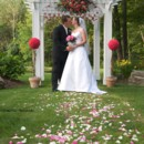 130x130 sq 1370036619935 paciotti.miller kiss in front of pergola credit shane east