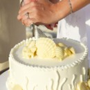 130x130 sq 1381770677645 cake cutting